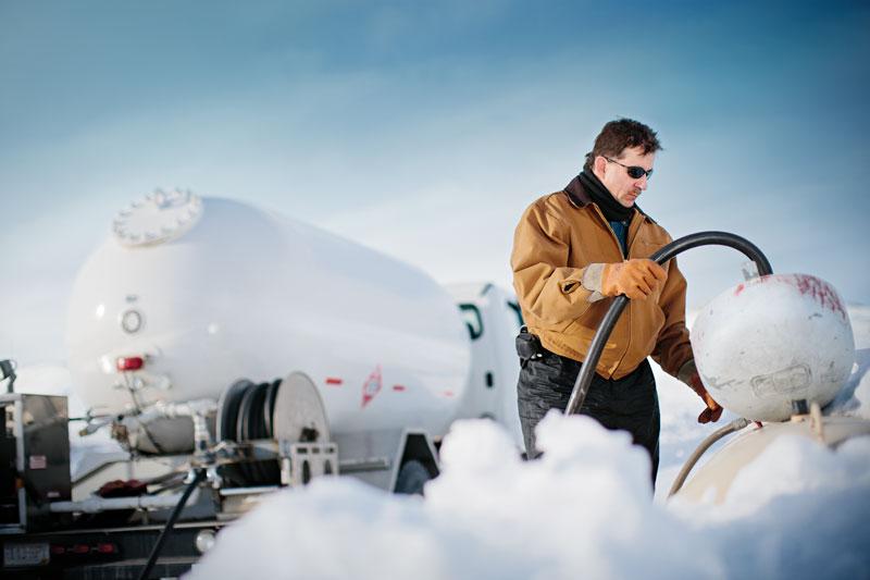 man refilling tank